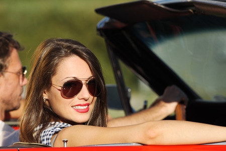 Portrait of a couple in a convertible car on a sunny day Stock Photo - 22849025
