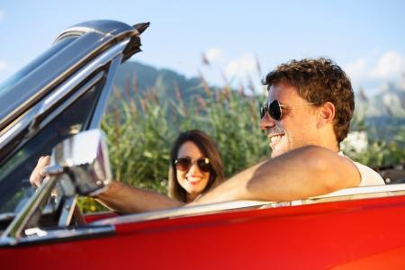 Beautiful couple enjoying in a convertible car ride Stock Photo - 22849029
