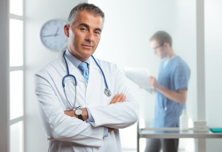 Portrait of a handsome male doctor, nurse on background photo