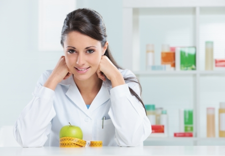 Portrait of a nutritionist female Doctor in her office photo