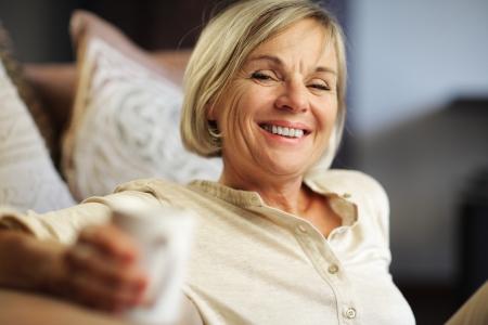 A pretty senior woman enjoying a cup of coffee  photo