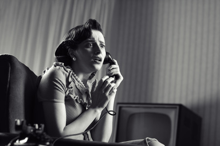 Shocked Woman talking on phone, vintage image photo