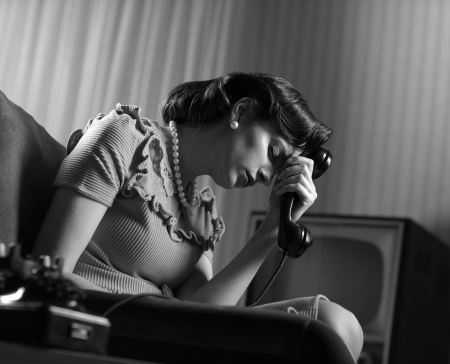 alone sad: Depressed woman with old telephone at home Stock Photo