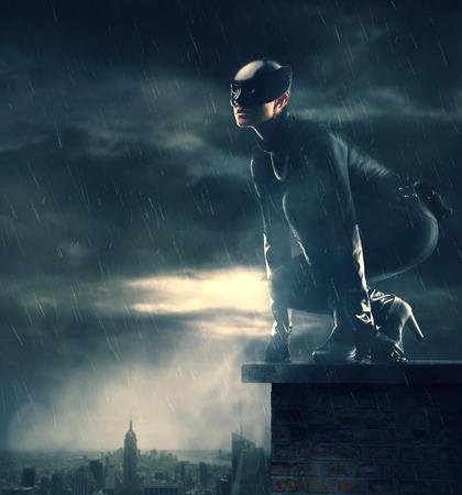 Female Superhero watching over the city photo