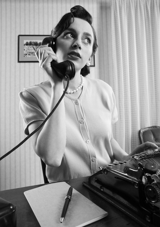 Office Worker talking on the phone Stock Photo - 23339061