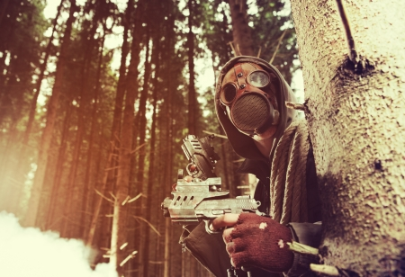 Soldier wearing a gas mask is fighting for its survival Stock Photo