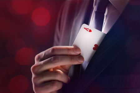 The Magician with ace card hidden under the jacket
