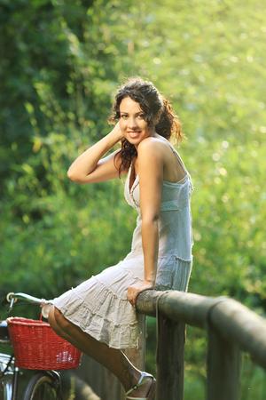Young beautiful woman relaxing outdoors photo
