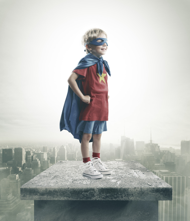 day dream: A young boy dreams of becoming a superhero Stock Photo