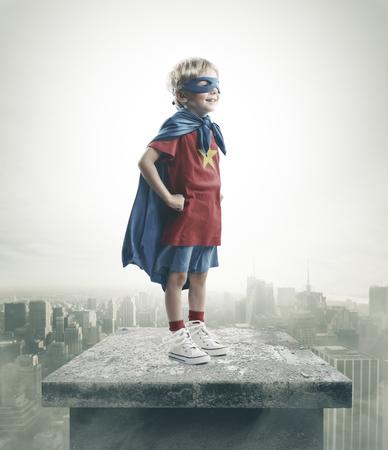 day dreams: A young boy dreams of becoming a superhero Stock Photo