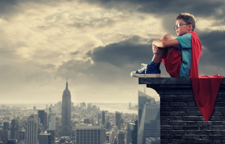 A young boy dreams of becoming a superhero. photo