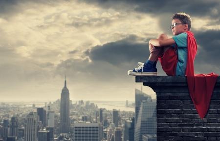 imagination: A young boy dreams of becoming a superhero. Stock Photo