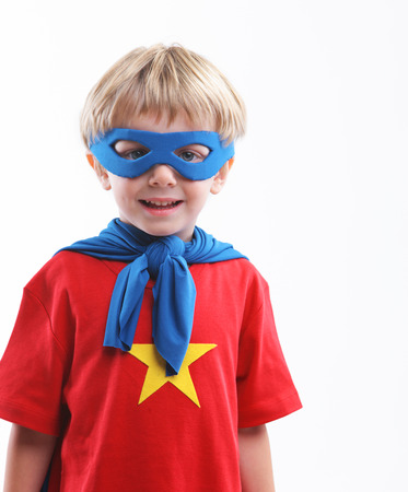 playtime: Portrait of a young superhero on white background Stock Photo