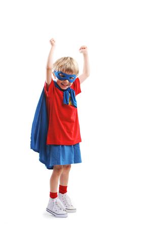 crime fighter: Portrait of a cheerful little boy superhero  Stock Photo