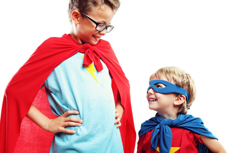 Two superheroes are ready to save the world. Stock Photo