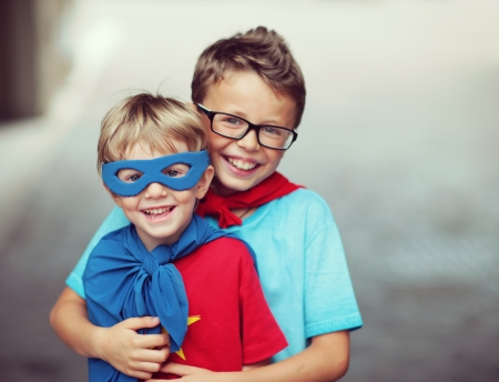 crime fighter: Portrait of two little cheerful superheroes