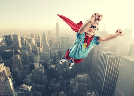 superhero cape: A little superhero ready to save the world Stock Photo