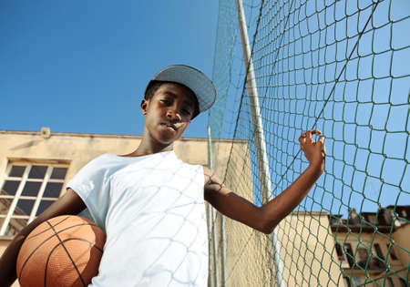 boy basketball: Portrait of african boy with basketball