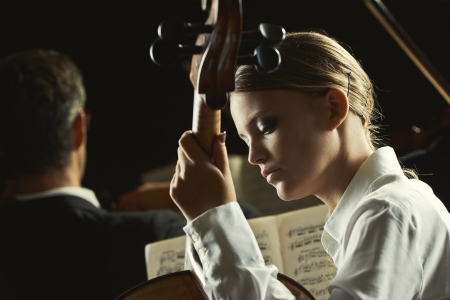 Young beautiful woman playing cello in orchestra Stock Photo - 23379443