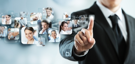 Businessman finger touches virtual buttons photo