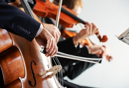 cellist: Cellist and violinist playing at the concert Stock Photo