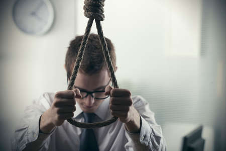 A desperate Young businessman, to commit suicide photo