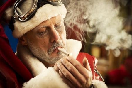 Portrait of Bad Santa smoking a joint