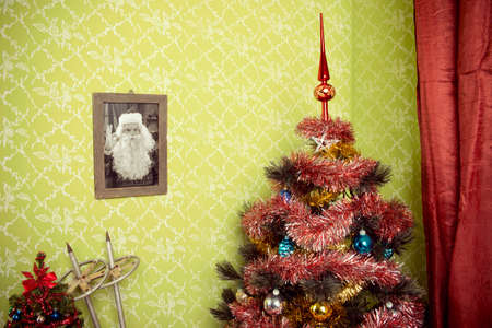 Close up of a room with vintage wallpaper and Christmas tree