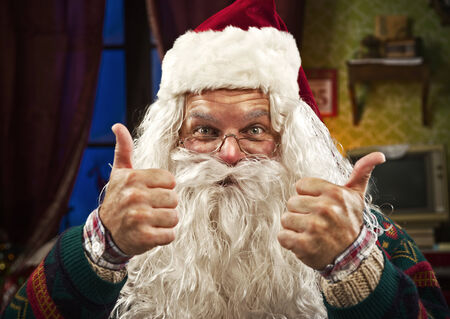 Portrait of Vintage Real Santa Claus two thumbs up photo