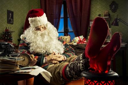 Portrait of Santa Claus sleeping on armchair photo