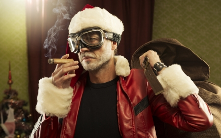 Bad Santa with gift bag smoking cigar  photo