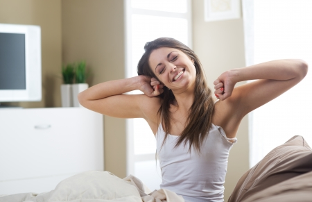 up wake: A lovely young woman stretching in the morning  Stock Photo