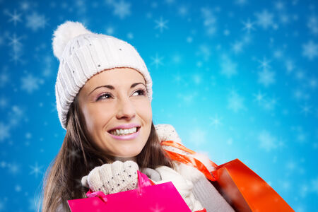 Happy young woman with her shopping bags photo