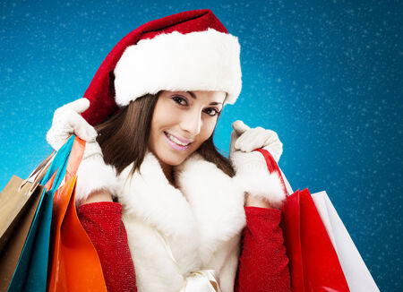 Young beautiful woman shopping for christmas gifts photo
