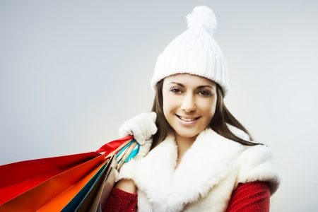 Beautiful young woman with her shopping bags photo