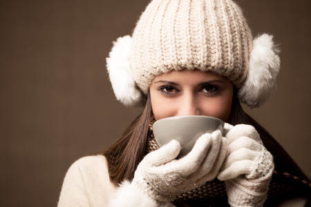 Portrait of beautiful winter woman with a cup of coffee or tea photo