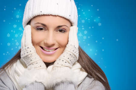 Portrait of a young beautiful woman wearing winter clothes photo
