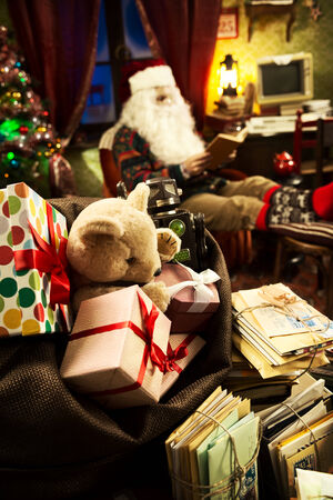 messy desk: The messy desk of Santa Claus, he reading a book