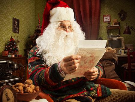 Portrait of Santa Claus reading a letter