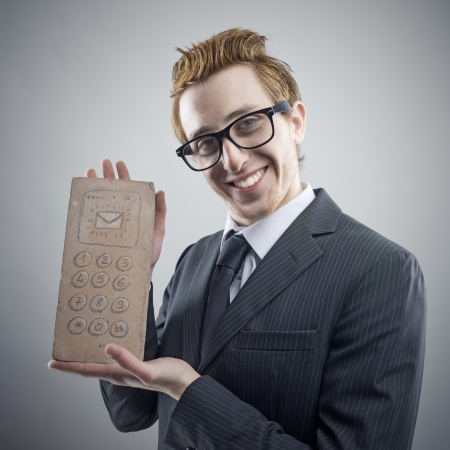 Portrait of mad Nerdy businessman with a unusual cell phone photo