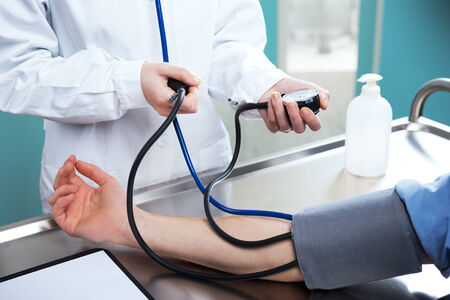 sphygmomanometer: The doctor measures pressure in the patient, close up