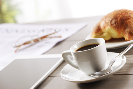 Business Office scene, digital tablet and newspaper with coffee  photo