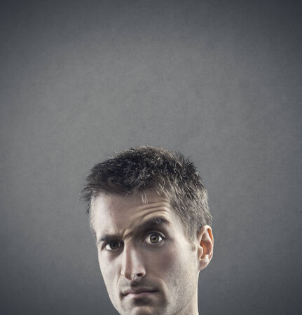Facial expression: doubt and suspiciousness. copy space