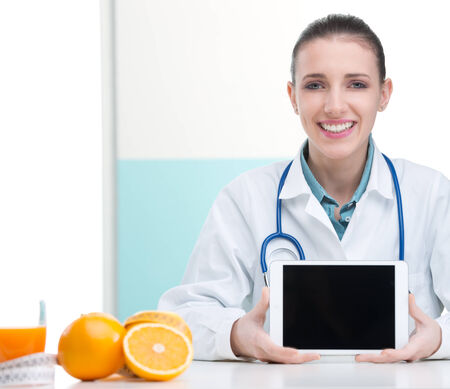 A portrait of cheerful healthcare professional promoting healthy eating photo