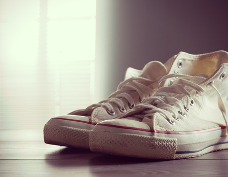 sneakers: White canvas shoes, youth culture and style.