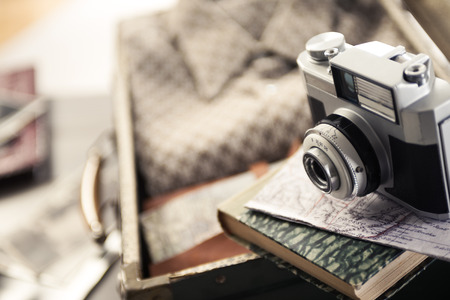 Vintage travel equipment with old camera and suitcase. photo