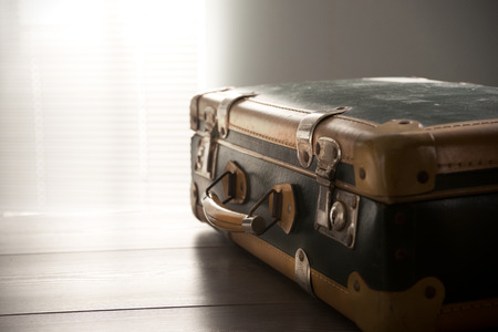 old suitcase: Vintage suitcase on a table, travel concept.