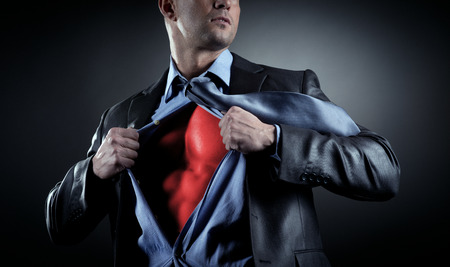 strong toughness: Attractive male businessman stripping off shirt and showing his muscular chest.