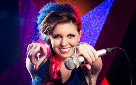 Young attractive singer on stage smiling at camera  photo