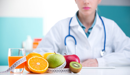 dietetics: Healthcare professional promoting healthy eating, focus on fruit Stock Photo